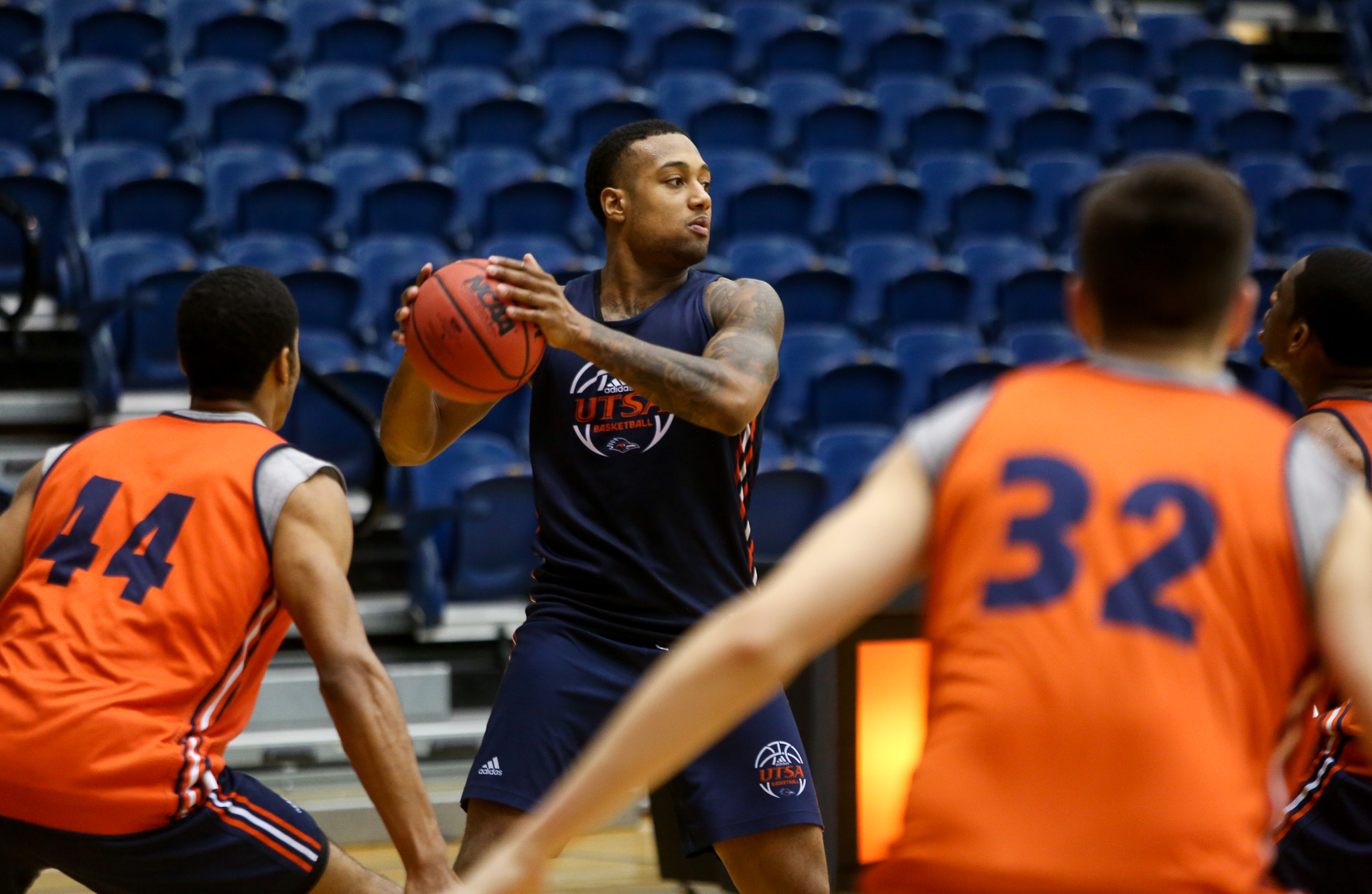 Jeff Beverly looks to pass to a teammate in a recent UTSA basketball practice.