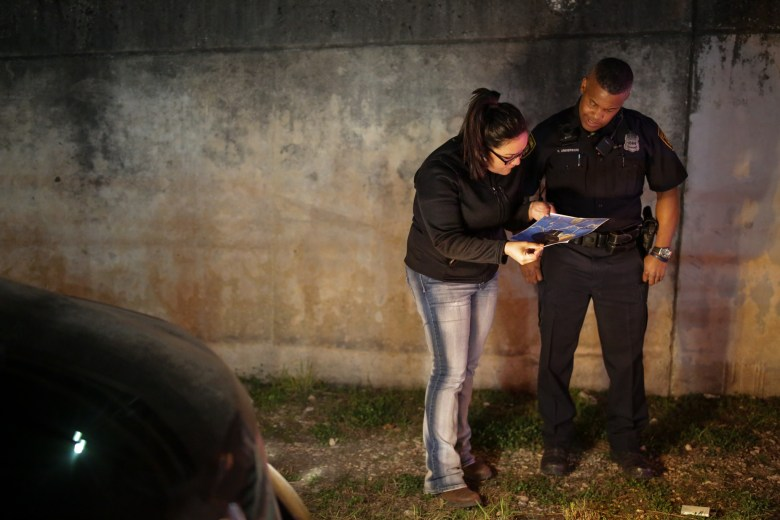 A volunteer works with ten year San Antonio Police Officer Herald Anderson during his first Point in Time count.