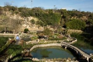 Architects tour the Sunken Gardens in Brackenridge Park.