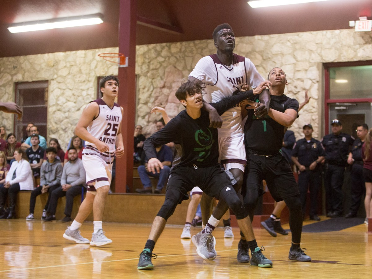 7-foot junior Ousmane Ndim vies for position as opponents attempt to obtain a defensive rebound.