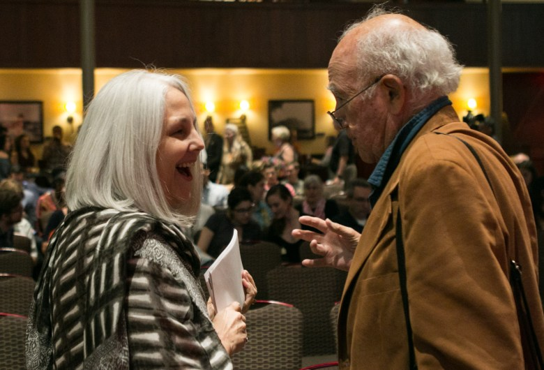 "From left, Elise Errutia and her father Dr. A. A. ""Bud"" Urrutia share a laugh before PechaKucha."