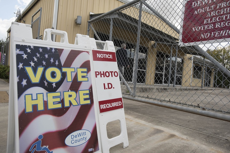 During the first week of early voting for the 2016 presidential elections, civil rights lawyers took issue with this sign outside of a polling place in Cuero. It did not mention options for casting a ballot without photo ID. Bob Daemmrich for The Texas Tribune