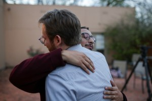 Mentors at Say Sí Stephen Guzman and Thomas Hopkins after hearing the news that Josué Ramero had been released by ICE.