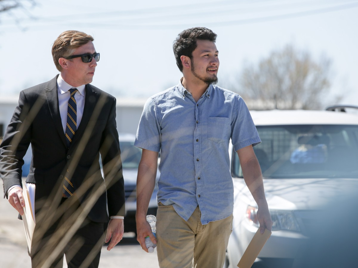 (left) RAICES Executive Director and Attorney Jonathan Ryans walks with client and DACA student Josue Roméro to a press conference before a scheduled appointment with ICE (Immigration and Customs Enforcement). officials