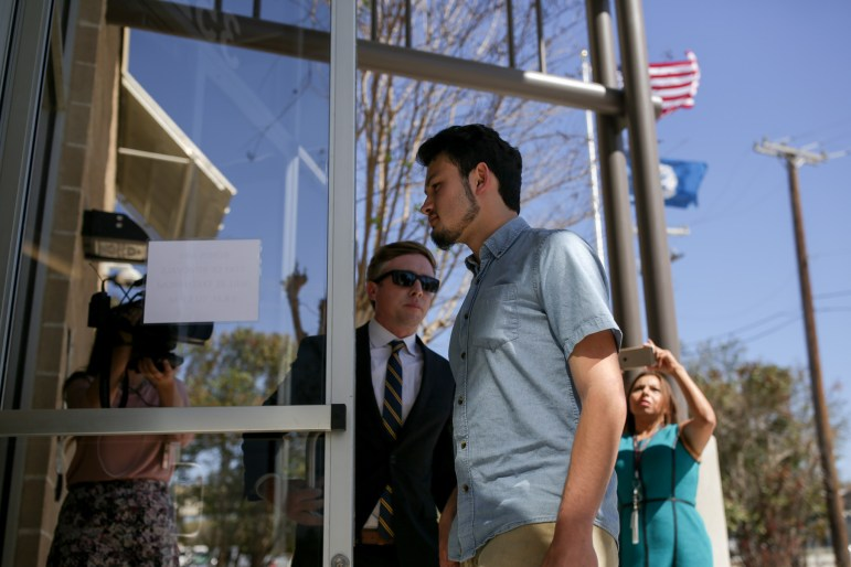 RAICES Executive Director and Attorney Jonathan opens the door for DACA student Josue Roméro during a scheduled check in with ICE (Immigration and Customs Enforcement).