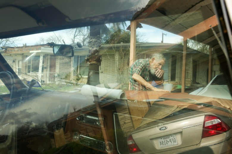 Albert Thomas, 87, at his home which he has lived in for 55 years sustained damages following an F1 tornado along his street.