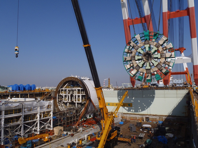 """Japanese crews in 2013 assemble """"Bertha,"""" the tunnel-boring machine that is being used as part of a massive infrastructure project in Seattle."""