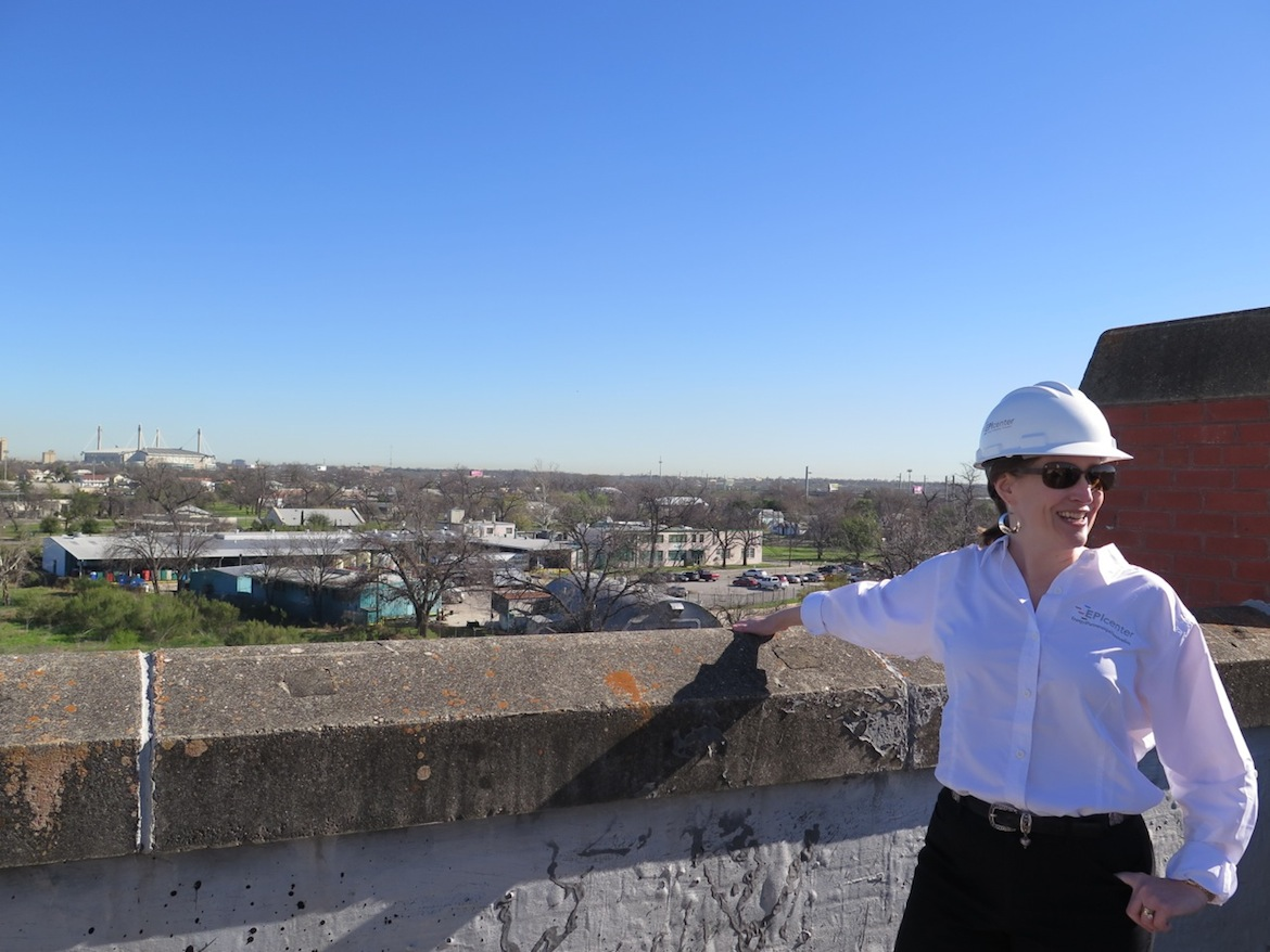 EPIcenter Director of Development Jill Vassar points out over the view of downtown from the EPIcenter.