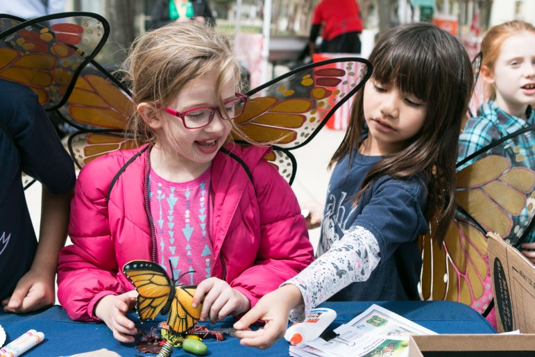 "Samantha, 7, and Aimee, 7, play with insect and butterfly figurines at the ""Monarchs, Milkweed and Migration"" event at Hemisfair Park on March 3."