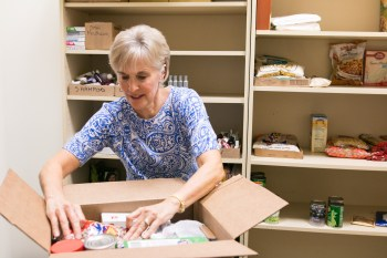 SA Cancer Council volunteer Carla Bergner packs boxes of food for patients at the CTRC Food Pantry.