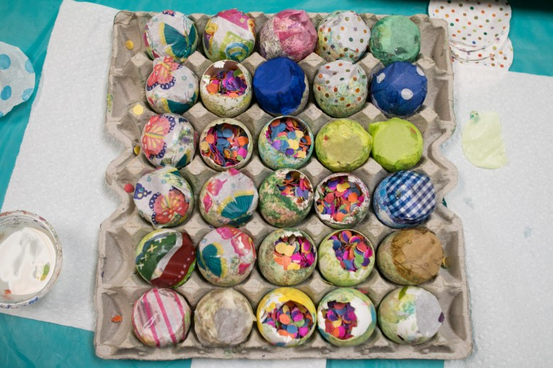 Confetti-filled eggs wait to be completed with tissue paper to make a cascarón.