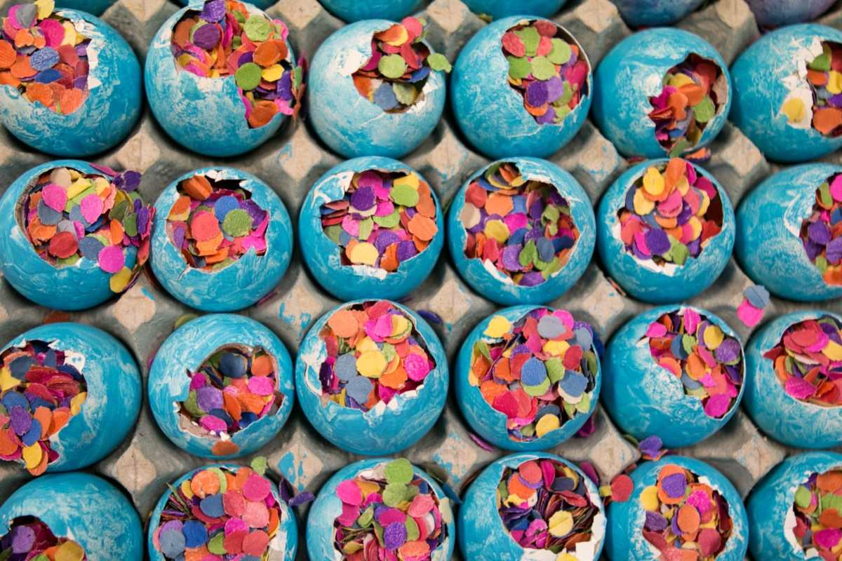 Confetti-filled eggs wait to be completed with tissue paper finish the cascarón.