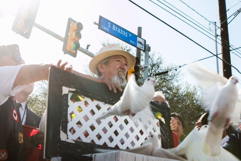 Jaime Martinez releases doves before the Official 21st Anniversary Cesar E. Chavez March For Justice.