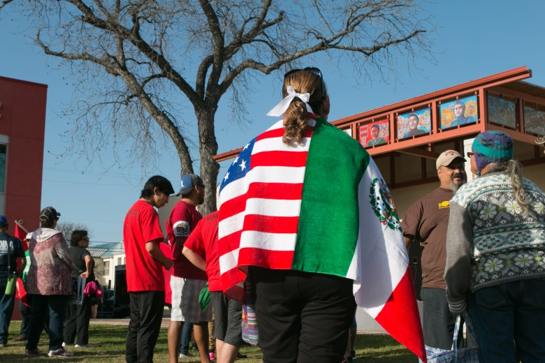 Maria Yznaga wears an attached American and Mexican flag for the Official 21st Anniversary Cesar E. Chavez March For Justice.