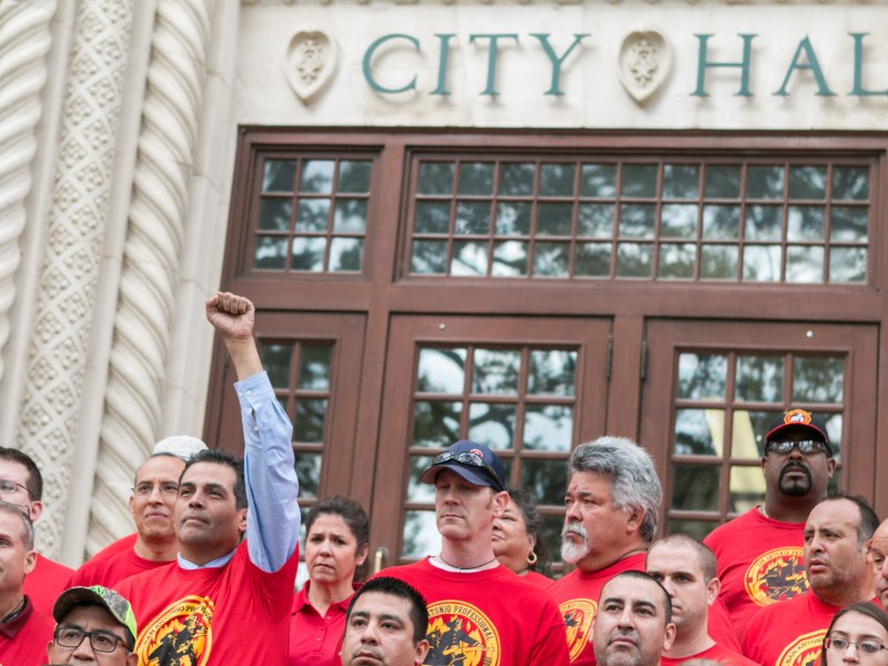 Gabriel Rosales raises his hand at passing supporters at the announcement of the San Antonio Professional Fire Fighters Association Local 624's choice for the next Mayor of San Antonio at City Hall.