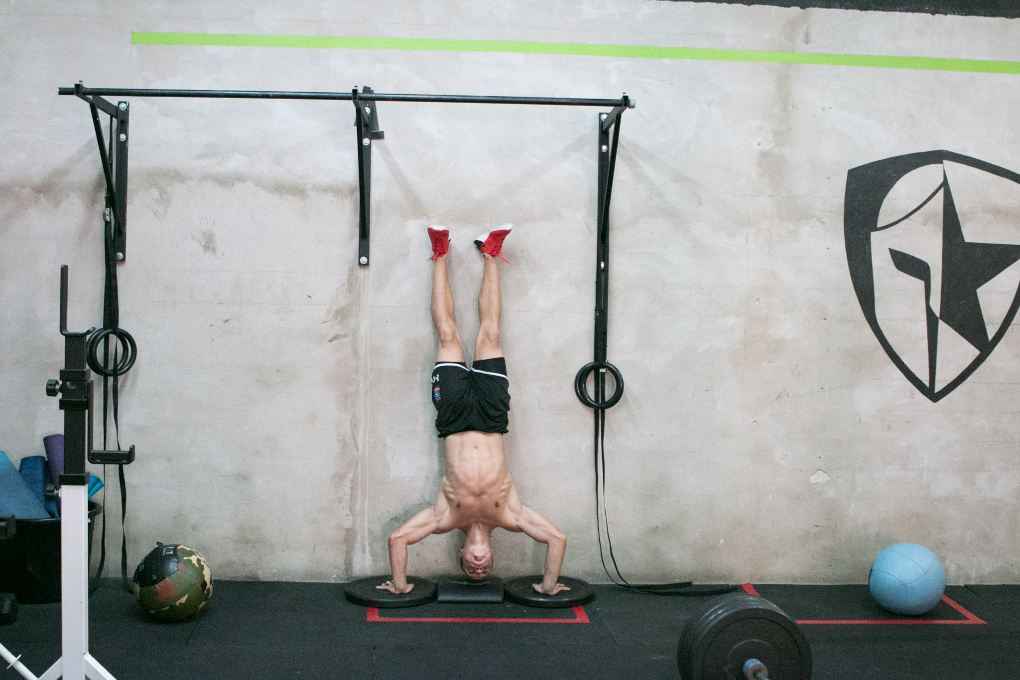 Lufe Torres practices his hand stand pushups before the opening stage of the CrossFit Games.
