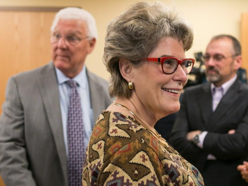 Former Bexar County Sheriff Susan Pamerleau smiles before the meeting.