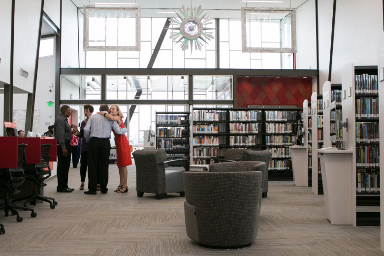 San Antonio Public Library Foundation President Tracey Bennett (right) greets visitors in the Schaefer Branch Library.