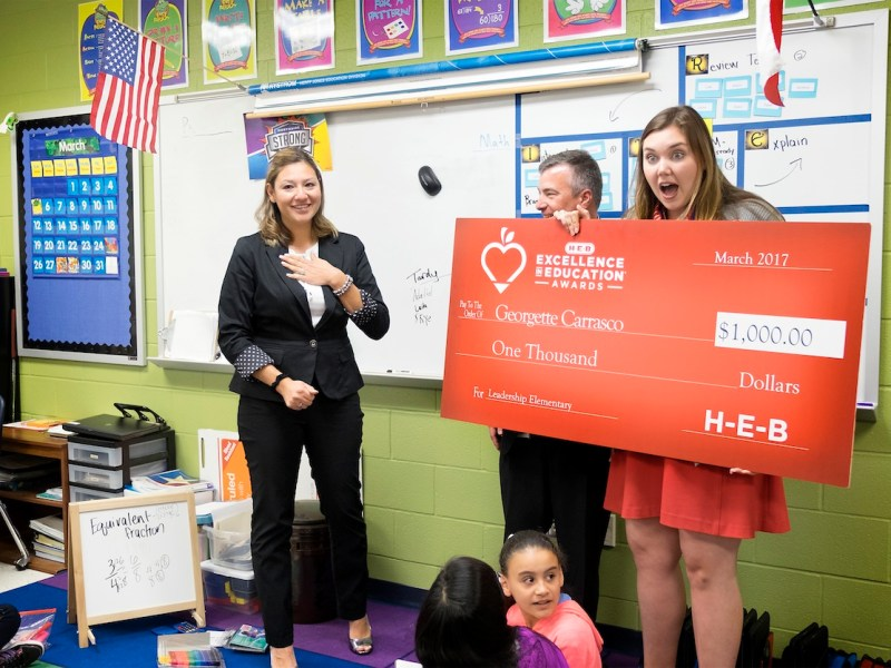 Georgette Carrasco (left) is surprised with a $1,000 check in her class room at Kay Franklin Elementary in Northside ISD. Carrasco is a finalist for the 2017 H-E-B Excellence in Education Awards.