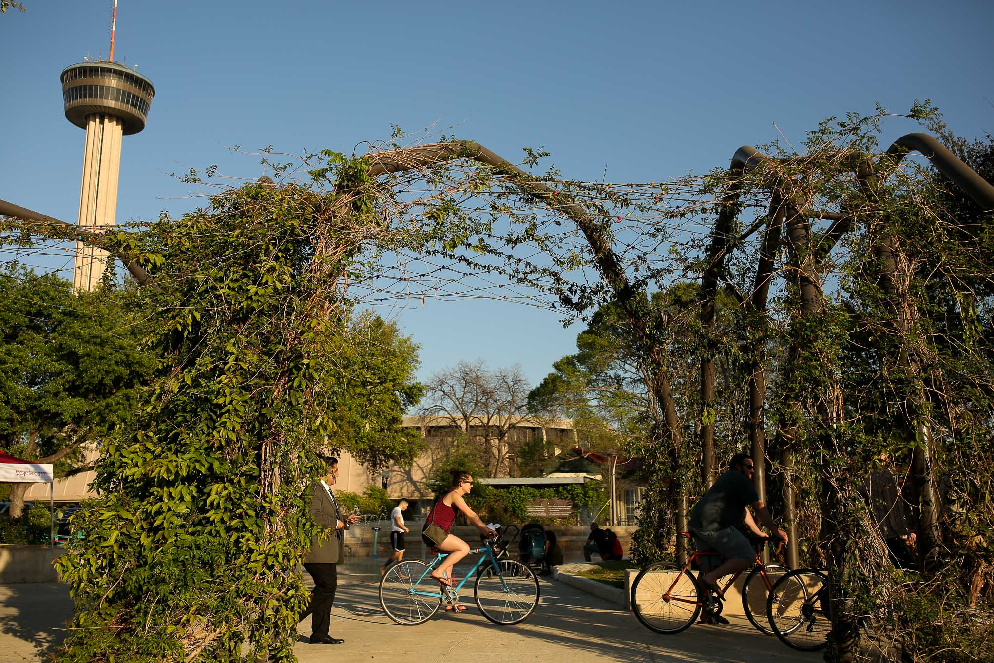 Attendees on bicycles depart from Yanaguana Garden for Blue Star.