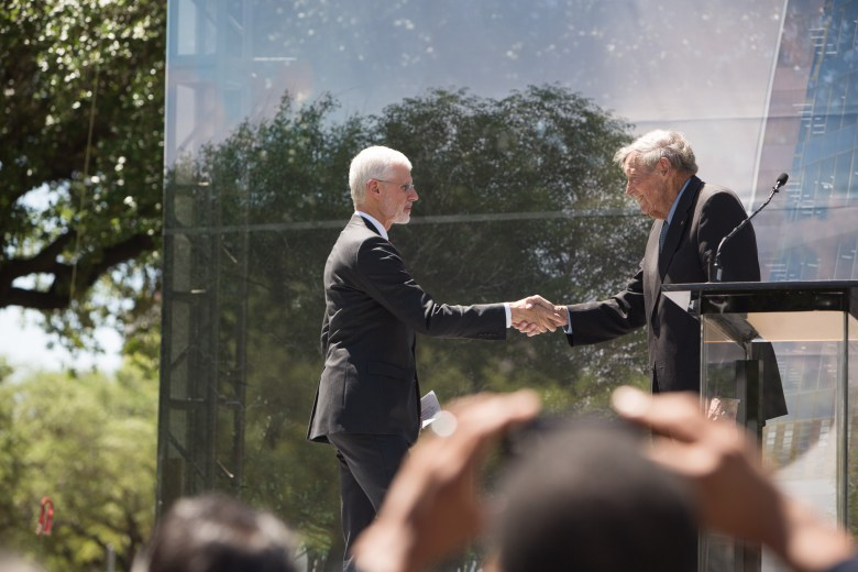 Frost Bank Chairman Emeritus Tom Frost Jr. shakes hands with Frost Bank Board Chair and CEO Phil Green.