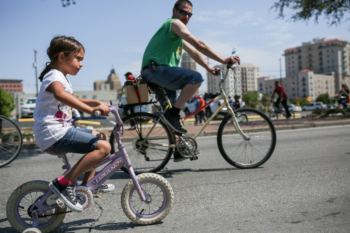 Riders of all ages take to South Saint Mary's Street.