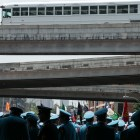 The Texas Cavaliers pass under the highway during the Battle of Flowers Parade.
