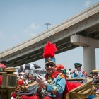 King Antonio XCV Dr. Michael Casillas claps to the music in the Battle of Flowers Parade.