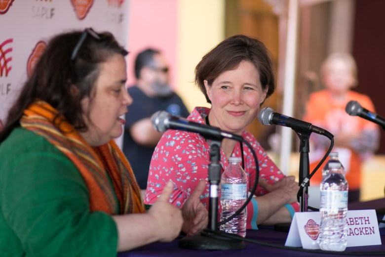 Writer Ann Patchett (right) smiles at her good friend and moderator writer Elizabeth McCracken in front of a large crowd at the San Antonio Book Festival.