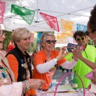 (From left) San Antonio Public Library Foundation's Carol Black, Carol Lavender, and Shannon Murphy sell items such as fiesta medals and tote bags during the San Antonio Book Festival.
