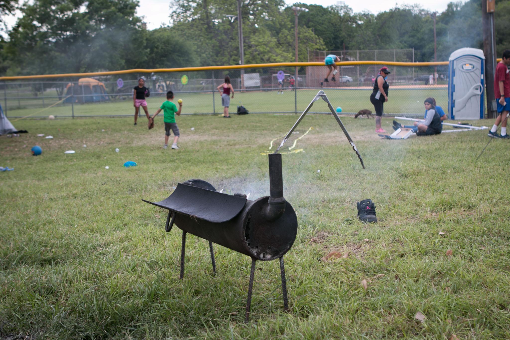 Families cook during Easter weekend at Brackenridge Park.
