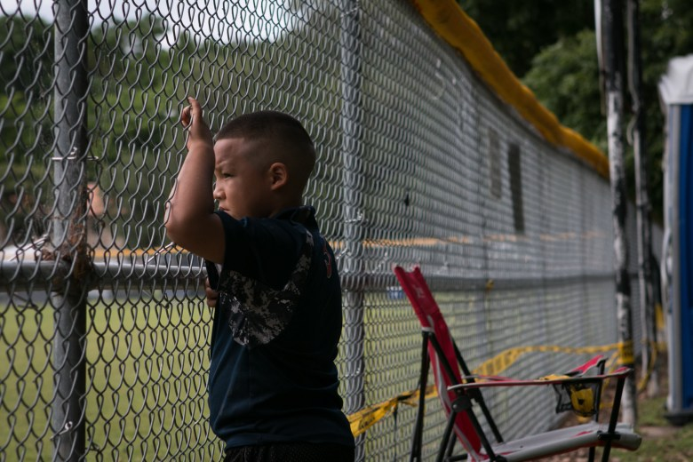 Gabriel, 6, watches a baseball game from his campsite during Easter weekend in Brackenridge Park.
