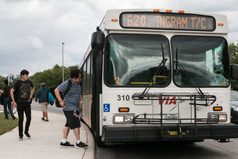 Students board a bus at Northwest Vista College in District 6.