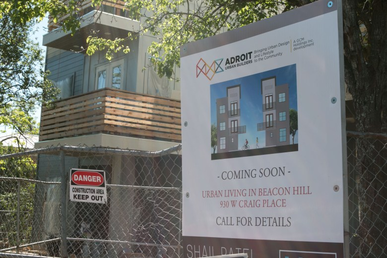 Amid some neighborhood protest, modern condominiums are being built in Beacon Hill at 930 W. Craig Pl.
