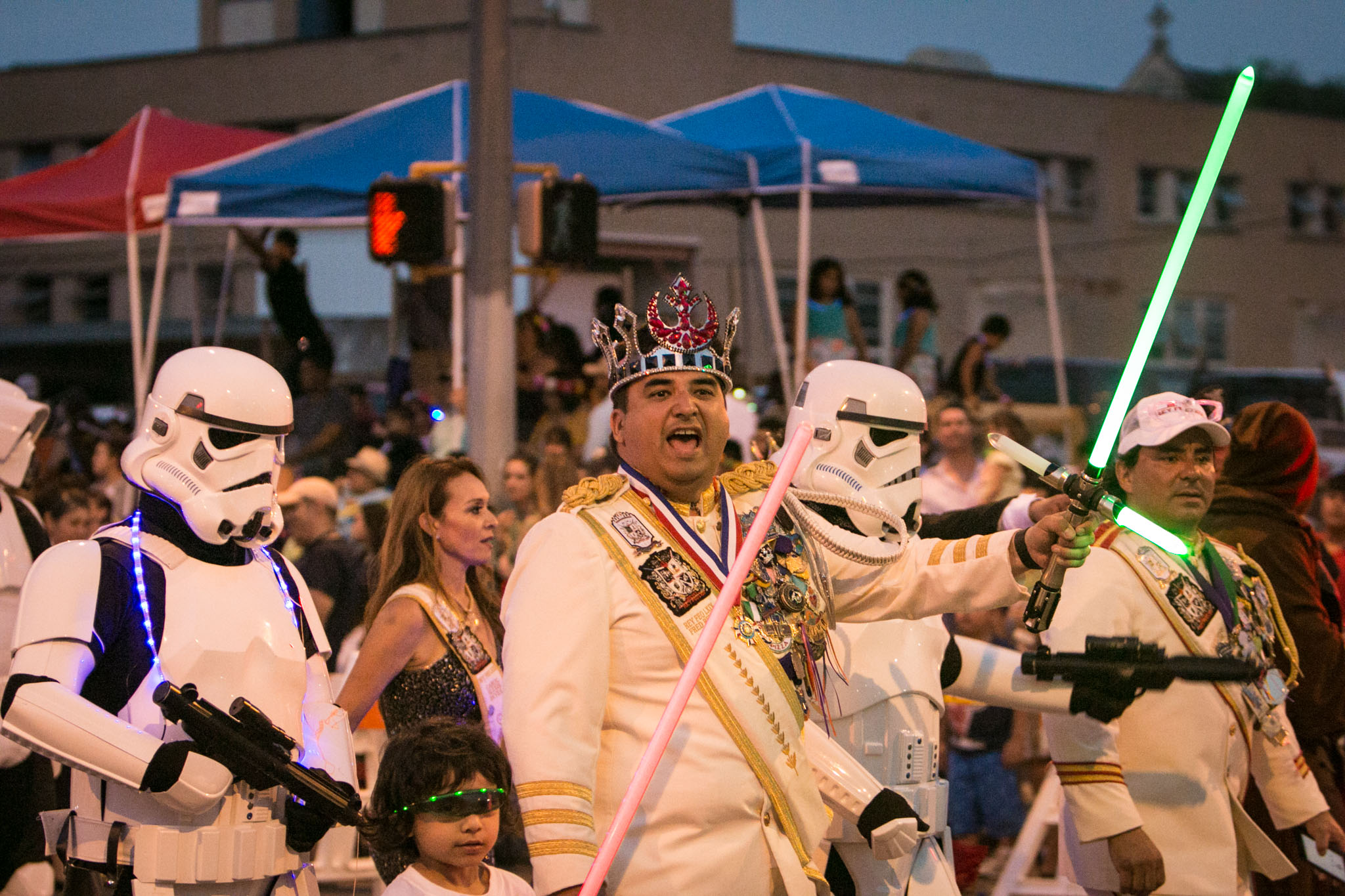 Rey Feo LXIX Fred Reyes flashes his lightsaber during the Fiesta Flambeau Parade.