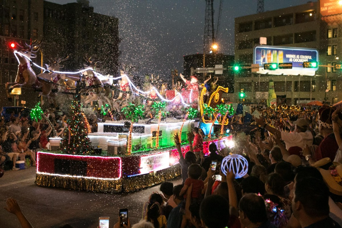 Floats light up the crowd during the Fiesta Flambeau Parade.