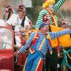 Clowns wave to the crowds in the Fiesta Flambeau Parade.