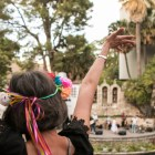A woman waves her hands to the music at Arneson River Theatre during NIOSA.
