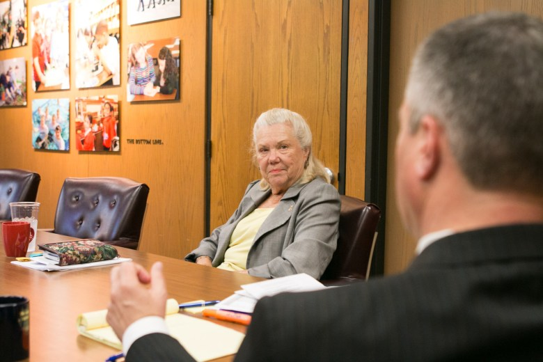 Northside Independent School District Superintendent Brian Woods (right) converses with Northside Independent School District President of the Board of Trustees Katie Reed in his office.