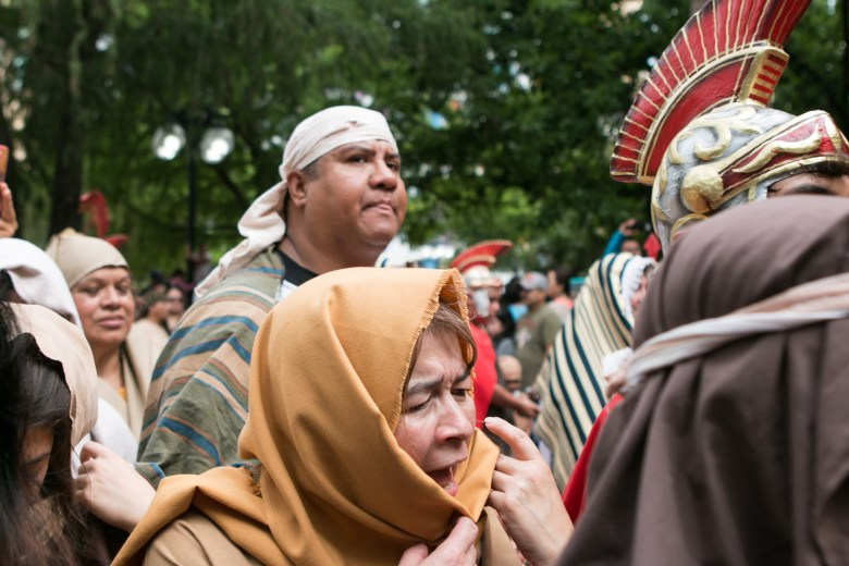 Actors and actresses cry out in emotion at the Passion of Christ Procession.
