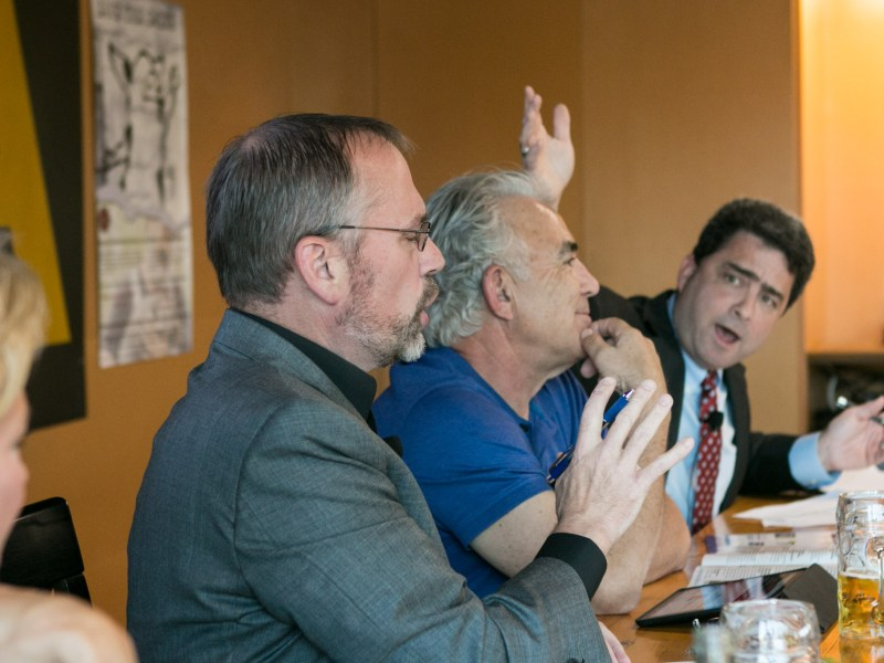 One SA Campaign Manager Christian Archer (left) argues with Republican Consultant Carlton Soules (right) over mediator Rivard Report Director Robert Rivard (center) at Pints + Politics: Bond & Brew Edition.