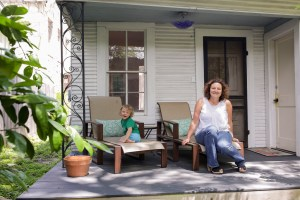 Jen and her daughter June sit on the front porch of their Southtown Airbnb.