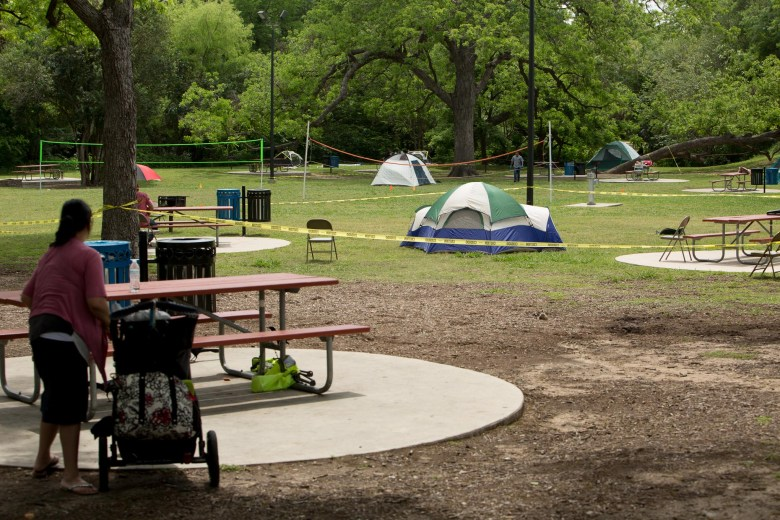 Tents fill a green space near the San Antonio Zoo train depot as this becomes a popular camping spot during the holiday weekend.