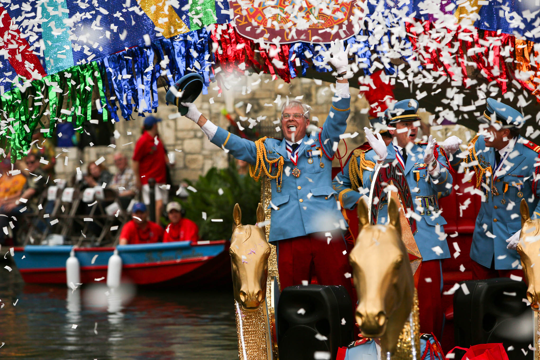 Texas Cavaliers wave as confetti floats down at Arneson River Theater.