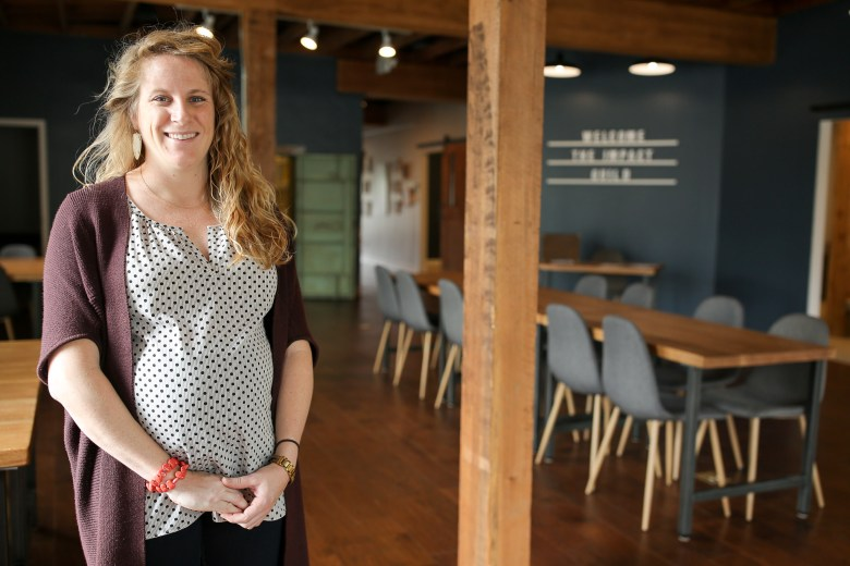 Founder of the Impact Guild Sarah Woolsey poses for a portrait in the co-working space.