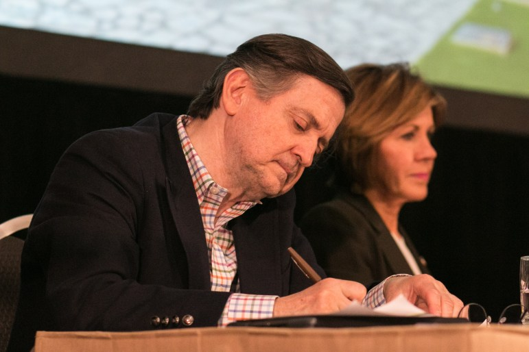 Alamo Master Planner George Skarmeas (left) takes notes while City Manager Sheryl Sculley listens to comments from the audience at the public input meeting for the Alamo Master Plan.