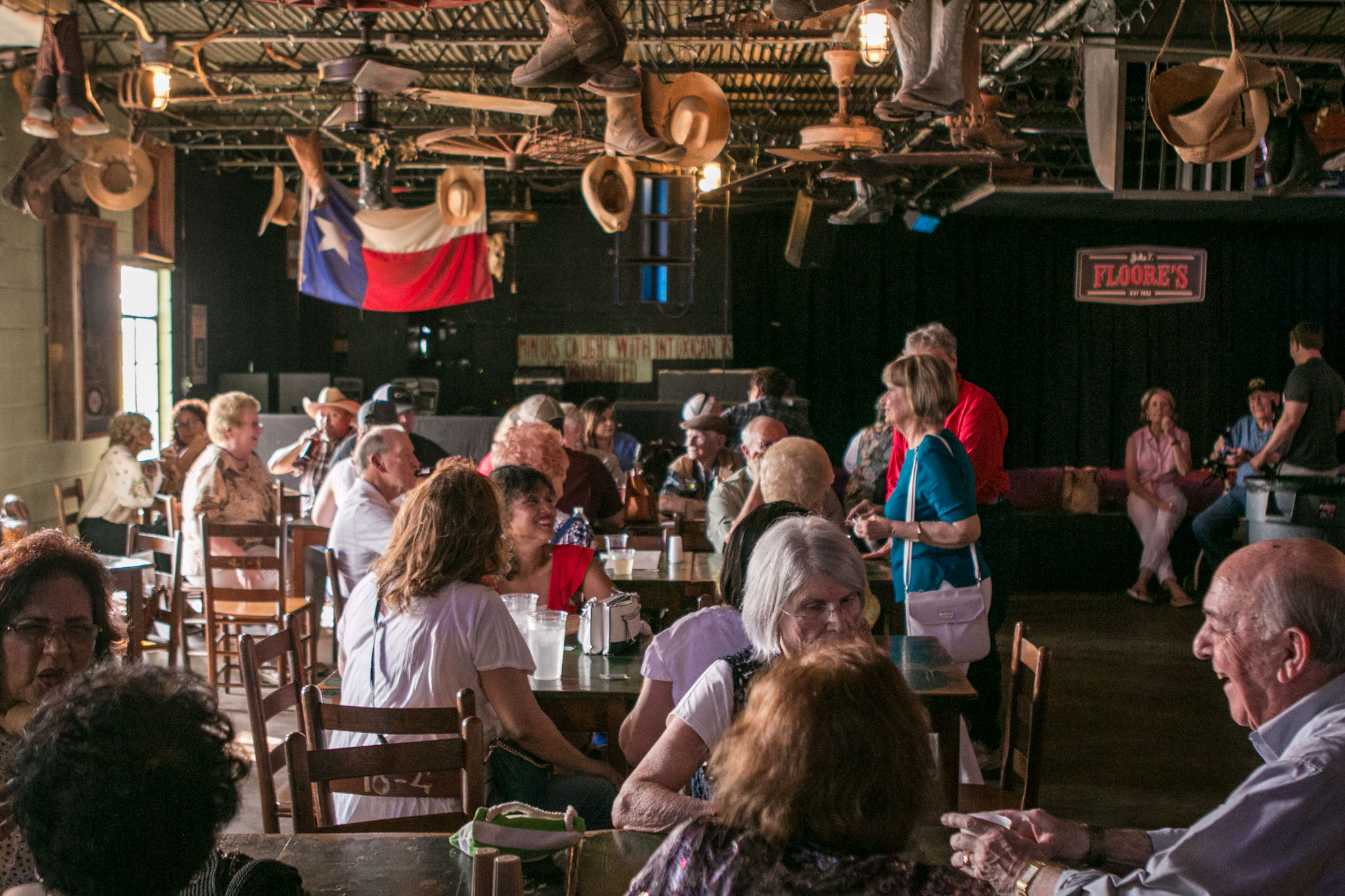 A large crowd gathers at John T. Floore's Country Store in Helotes for a reunion to celebrate 100 years since the birth of Kelly Field.