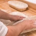 La Panadería co-owner David Caceres Galicia prepares loaves of bread at La Panaderia.