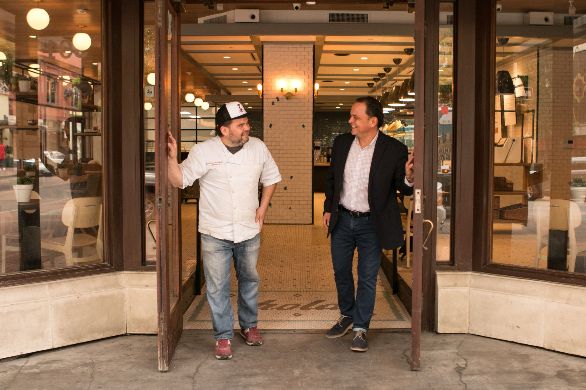 La Panadería co-owners and brothers (from left) David Caceres Galicia and José Caceres open the doors to the Houston Street entrance of La Panaderia.