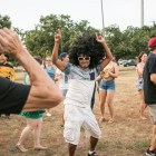Luis Valdez dances in the middle of a circle of people at the Gay Pride Mob Flash Dance in front of Mayor Ivy Taylors house.